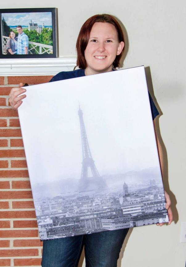 Amanda holding black and white photo of foggy Eiffel Tower